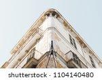 grunge house facade blue sky | Shutterstock . vector #1104140480