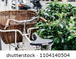 bike with basket on street | Shutterstock . vector #1104140504