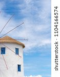 windmill and white building... | Shutterstock . vector #1104166574