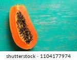 papaya fruit on wooden...   Shutterstock . vector #1104177974