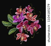 embroidery orchid flowers.... | Shutterstock .eps vector #1104185279