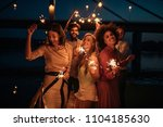 group of friends holding... | Shutterstock . vector #1104185630