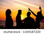 young adult summer beach party... | Shutterstock . vector #1104187220