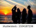 young adult summer beach party... | Shutterstock . vector #1104187238