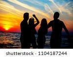 young adult summer beach party... | Shutterstock . vector #1104187244
