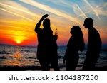 young adult summer beach party... | Shutterstock . vector #1104187250