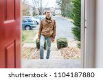 young man standing on front... | Shutterstock . vector #1104187880