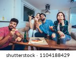 group of young friends eating...   Shutterstock . vector #1104188429
