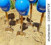 industrial blue hard hats on... | Shutterstock . vector #1104189719