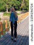 beautiful blonde girl in denim...   Shutterstock . vector #1104196724