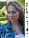 beautiful blonde girl in denim...   Shutterstock . vector #1104196748