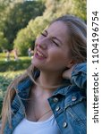 beautiful blonde girl in denim...   Shutterstock . vector #1104196754
