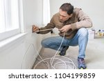 young man installing television ... | Shutterstock . vector #1104199859