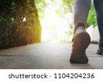 close up woman running shoes ...   Shutterstock . vector #1104204236