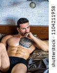 shirtless muscular sexy male... | Shutterstock . vector #1104211958