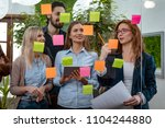 creative professionals standing ... | Shutterstock . vector #1104244880