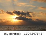sunrise on a tropical sea. | Shutterstock . vector #1104247943