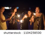 sparklers with group of friends ... | Shutterstock . vector #1104258530