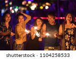 sparklers with group of friends ...   Shutterstock . vector #1104258533
