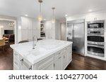 beautiful kitchen in new luxury ... | Shutterstock . vector #1104277004