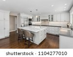 beautiful kitchen in new luxury ... | Shutterstock . vector #1104277010
