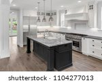 beautiful kitchen in new luxury ... | Shutterstock . vector #1104277013