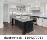 beautiful kitchen in new luxury ... | Shutterstock . vector #1104277016