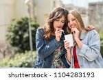 two young women drinking the... | Shutterstock . vector #1104283193