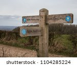 a sign points to the south... | Shutterstock . vector #1104285224