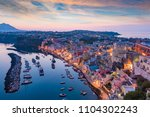 serene sea  colorful houses on... | Shutterstock . vector #1104302243