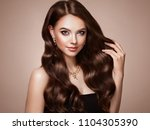 brunette girl with long healthy ... | Shutterstock . vector #1104305390