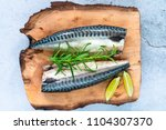 Stock photo two raw mackerels on wooden board top view 1104307370