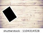 blank photo frame hanging on...   Shutterstock . vector #1104314528
