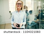smiling young businesswoman... | Shutterstock . vector #1104321083