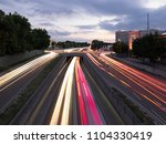 car traffic at night in neu ulm ... | Shutterstock . vector #1104330419