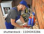 professional plumber in uniform ...   Shutterstock . vector #1104343286