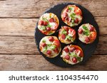 summer food  hot eggplant with... | Shutterstock . vector #1104354470