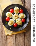 stuffed deviled eggs with tuna...   Shutterstock . vector #1104354506