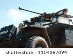 Small photo of Saunton, Devon, UK - 3rd June 2018: World War 2 reenactment (D-day) weekend. World War 2 reenactment (D-day) weekend. An actor in German infantry uniform on a period WW2 German armoured scout car.