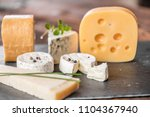 cheese board selection | Shutterstock . vector #1104367940