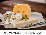cheese board selection | Shutterstock . vector #1104367970