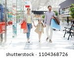 happy family of shoppers... | Shutterstock . vector #1104368726