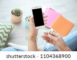 young woman holding mobile...   Shutterstock . vector #1104368900