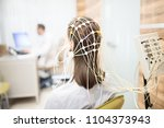 back view of patient with eeg... | Shutterstock . vector #1104373943