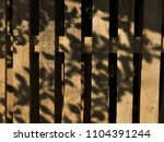 shadows from tree leaves on... | Shutterstock . vector #1104391244
