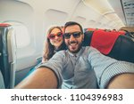 young handsome couple taking a... | Shutterstock . vector #1104396983