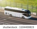 tourist bus speeding on highway ... | Shutterstock . vector #1104400823