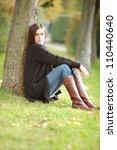 woman in autumn park | Shutterstock . vector #110440640