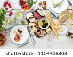 mediterranean appetizers table... | Shutterstock . vector #1104406808