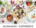 mediterranean appetizers table... | Shutterstock . vector #1104406814